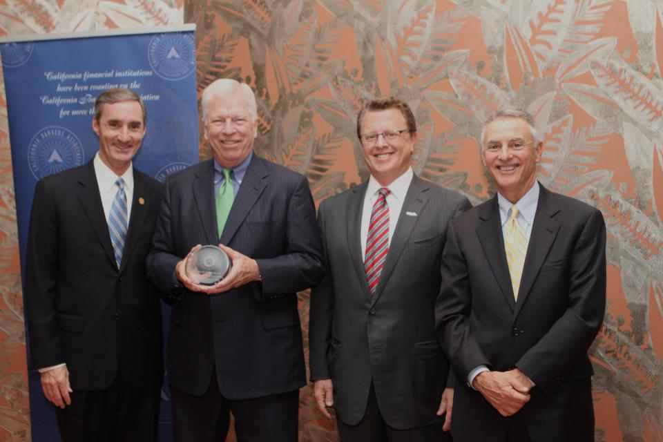 Rick Hartnack (second from L) receives the Distinguished Banker of the Year Award. Pictured with (from L) CBA Chairman Rick Sanborn, U.S. Bank's Regional President, Southern California Sean Foley and CBA Chairman-Elect Tad Lowrey.